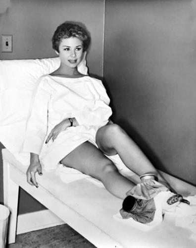 This image has an empty alt attribute; its file name is MITZI-GAYNOR-WITH-A-HURT-FOOT-STILL-CHEESECAKE-8X10-PHOTO-1.jpg