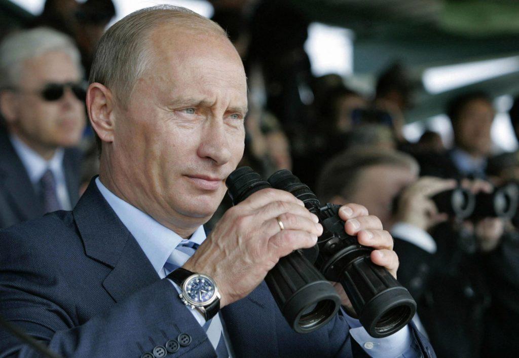 Putin looking through binoculars